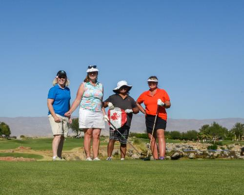 four women golfers