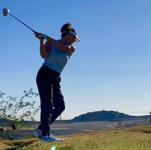 Woman Golfer at Backswing